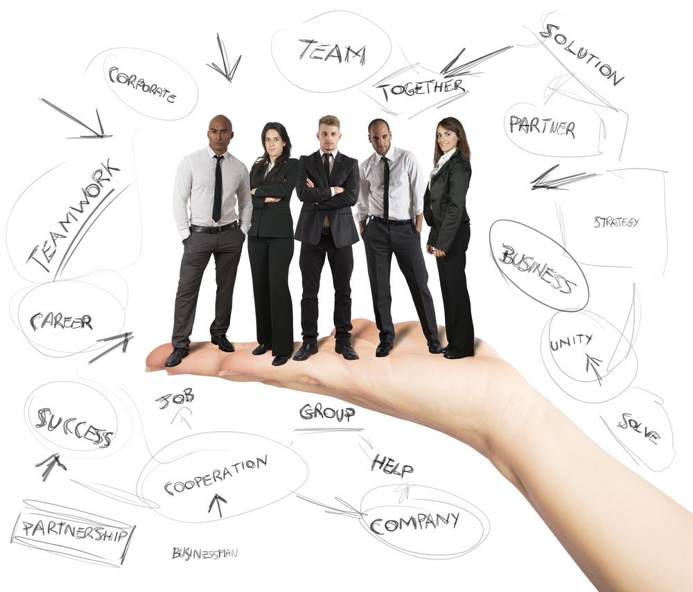 picture of a manager holding a team how to build your team as a new manager or supervisor