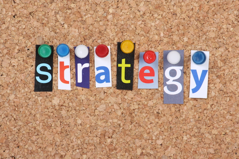 "Separate letters spelling ""strategy"" are pinned to a bulletin board"