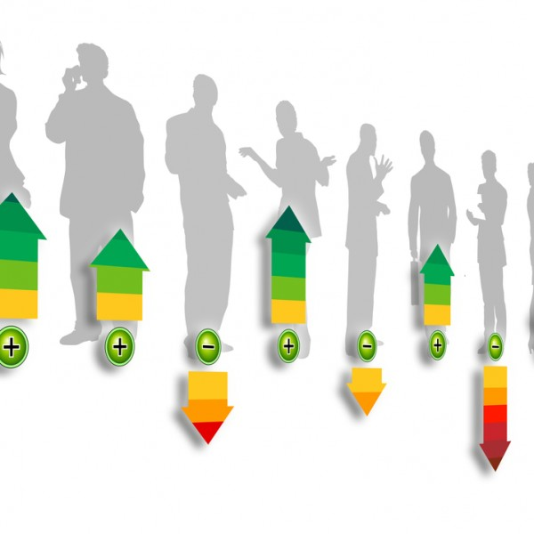 Shadows of business people are superimposed with arrows up or down as ratings of their engagement