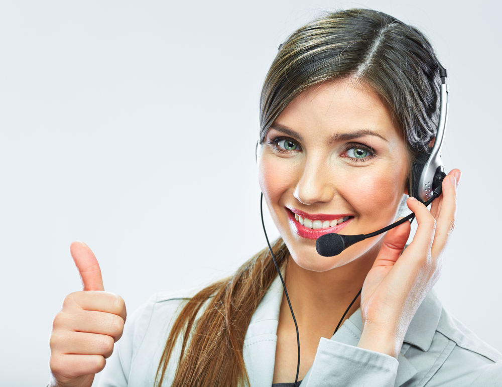 a woman on the phone with a smile and thumbs up
