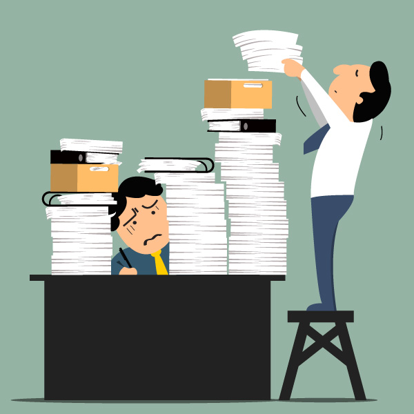 One cartoon man piles even more papers on the desk of an overworked employee