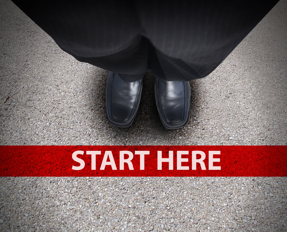 "High Performing Sales Team shoes are lined up against a red line entitled ""Start Here"""
