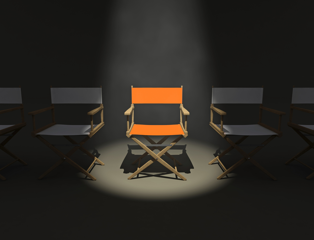 One out of 5 directors' chairs is spotlighted