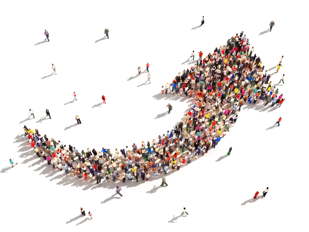 hundreds of people are grouped into the shape of an up arrow Talent Selection Blind Spots