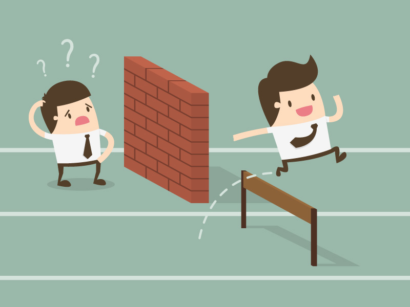 Decrease Employee Engagement a cartoon of 2 businessmen running a race, one blocked by a wall, the other successfully leaping over a hurdle