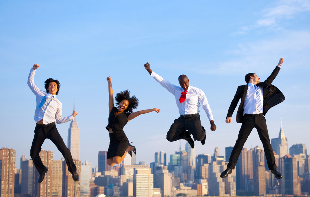 Beyond Employee Engagement 4 happy people are jumping in the air