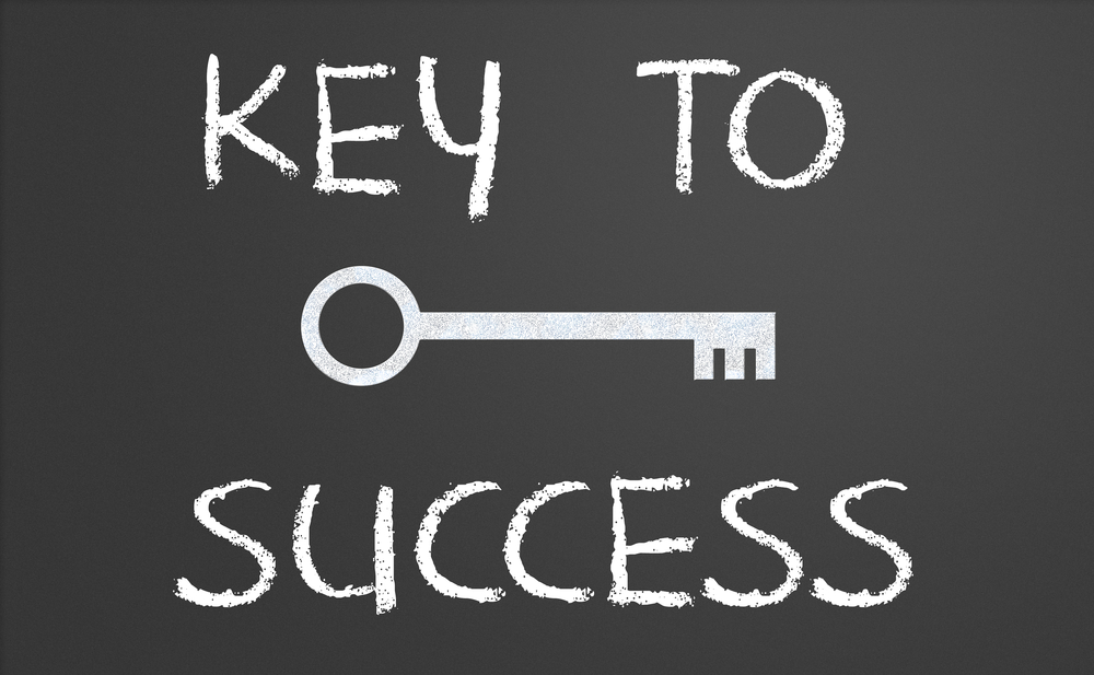 "The words ""Key to Success"" are written on a blackboard"