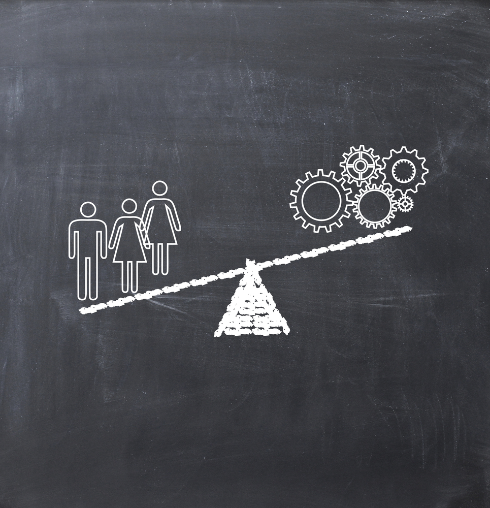 Better Leverage Talent Management Drawing of a seesaw on the blackboard with three stick figures outweighing machine gears