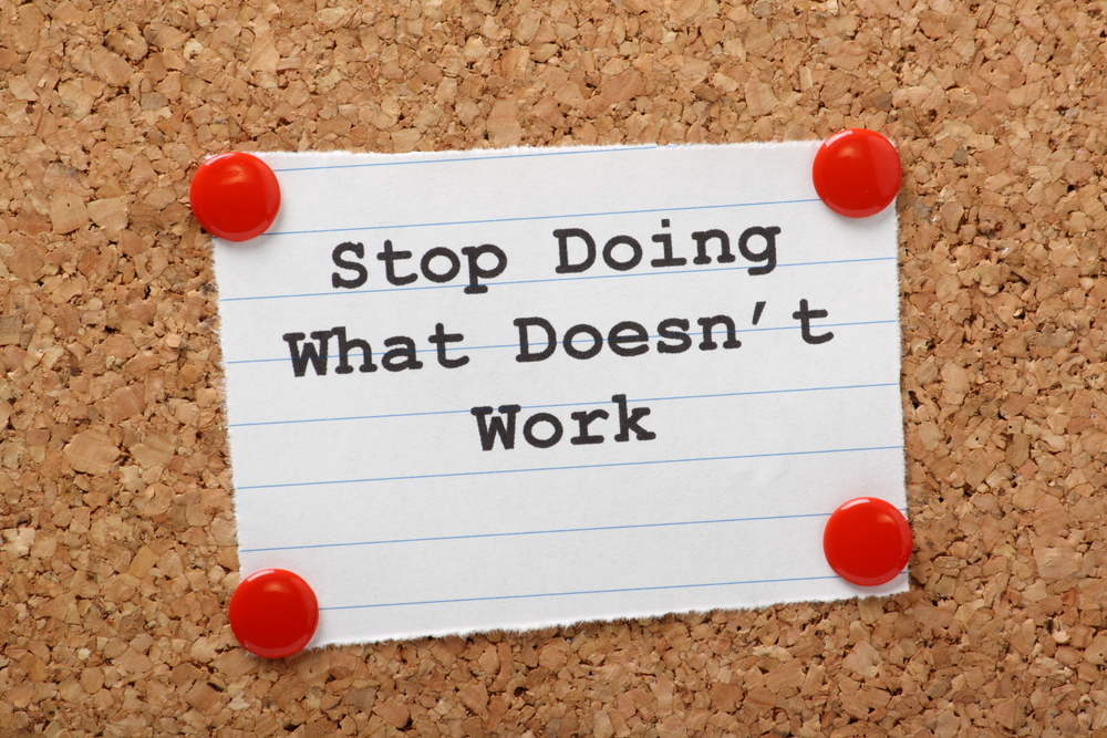 "A Note to new managers on a bulletin board reading ""Stop Doing What Doesn't Work"""