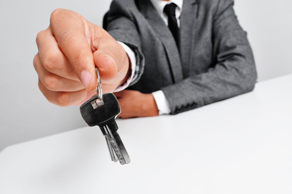 a businessman is holding keys perhaps for employee engagement