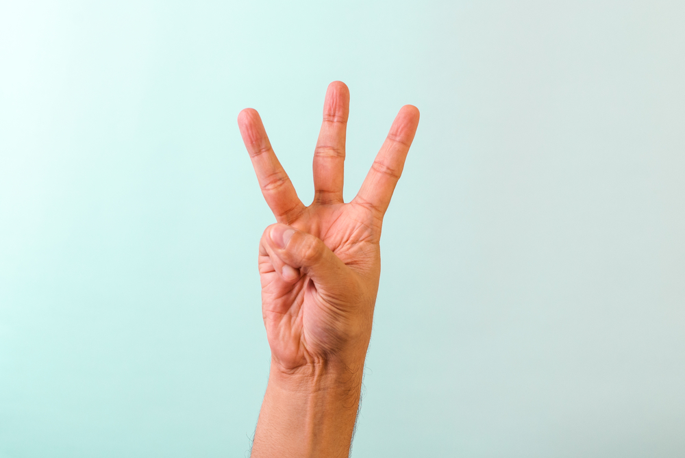 Picture of a hand with three fingers raised for new managers success