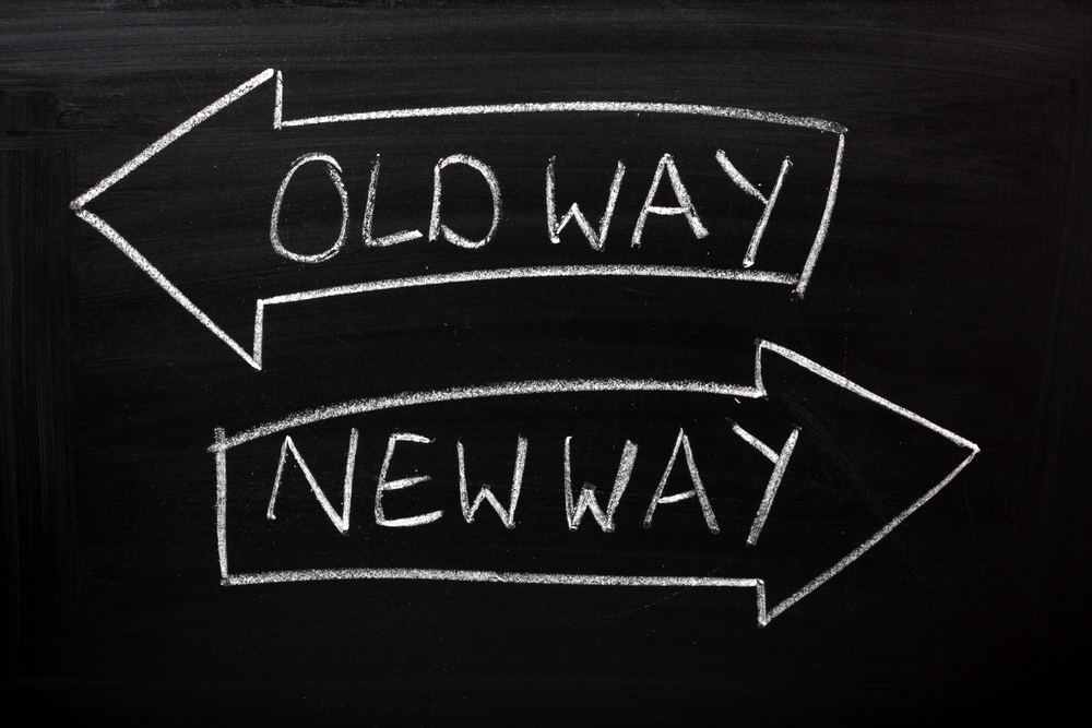 organizational change tips On a blackboard an arrow entitled Old Way and one entitled New Way point in opposite directions illustrating how change management consulting can be