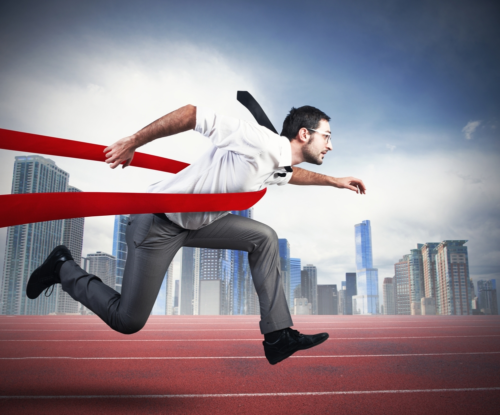 Customer Centric Strategies a man is racing across the finish line to show his solution selling training success