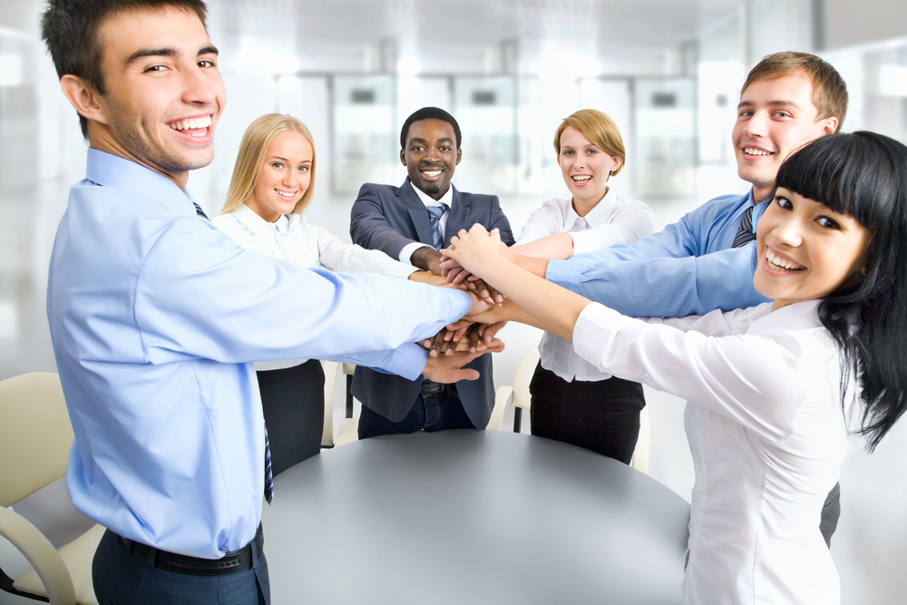 6 teammates in a circle to show a people first corporate culture