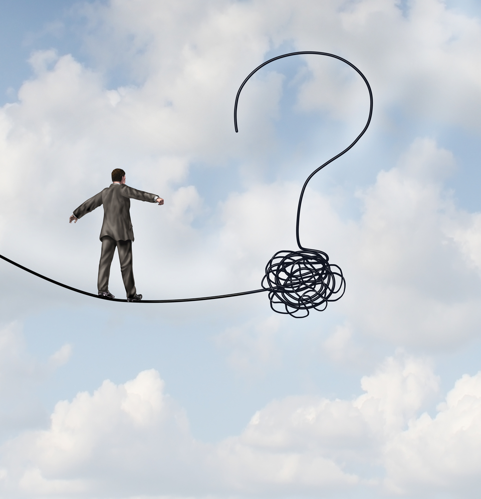man on a tightrope approaching a question mark symbolizing Talent Management Questions