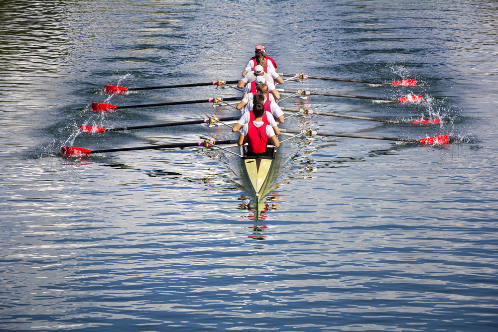 a crew shell with oars in perfect alignment to illustrate Strategy Aligns Behavior