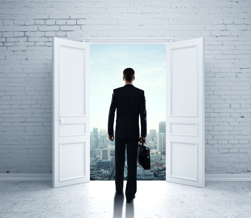 A man walking out an open door to illustrate High Sales Attrition