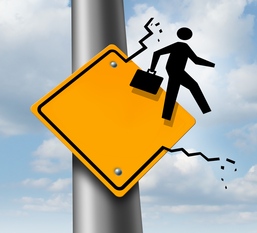 graphic of a businessman walking beyond the boundaries of a street sign to show how to Break Out of Your Comfort Zone