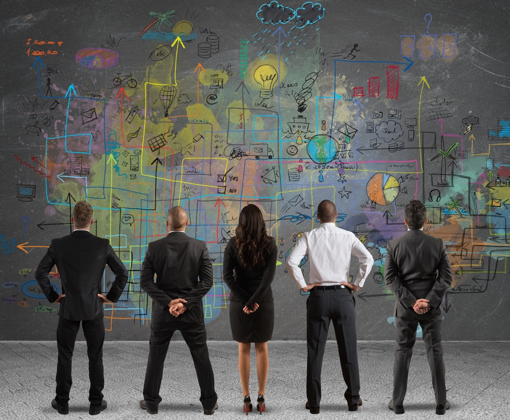 5 people looking at a business plan wondering how to cascade corporate strategies