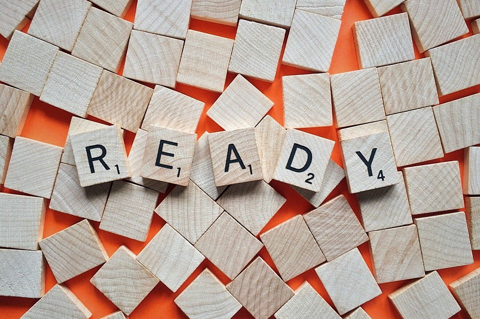 READY is spelled in Scrabble tiles to show How to Prepare for Organizational Change