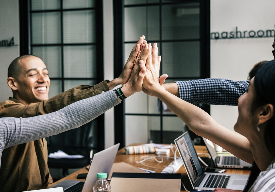 Happy employees show how to Keep Your Team Engaged